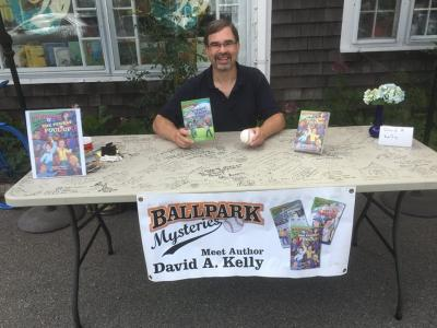 Photo of author David A. Kelly Signing books at The Brewster Book Store in 2018