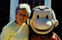 Owner Nancy Landon and Curious George