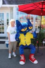 Photo of Pete the Cat on his last vist to the book store with our very own Nancy!